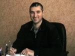 Володимир Лисак у директорському кріслі і в спортивному костюмі… Одним словом — спортивний директор