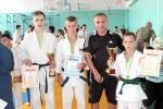 Тренер Матвєєв із своїми чемпіонами (зліва направо) Сергієм Лозовим, Кирилом Бодюлом і Станіславом Рибіним